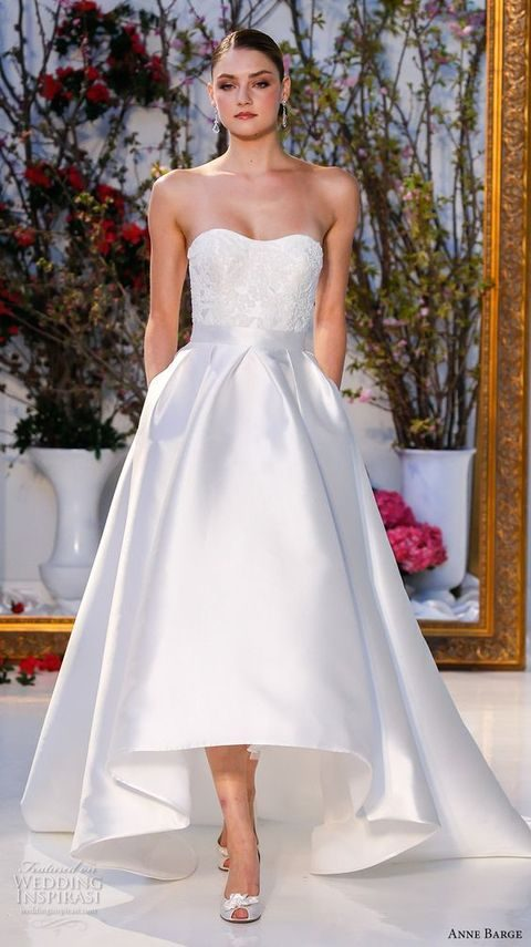 strapless lace bodice high low wedding dress with a train and pockets