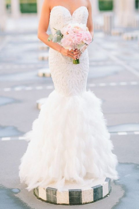 strapless lace embellished mermaid wedding dress with a feather tail
