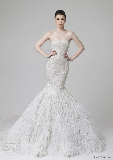 strapless mermaid wedding dress with a lace embellished bodice and a feather skirt by Rani Zakhem