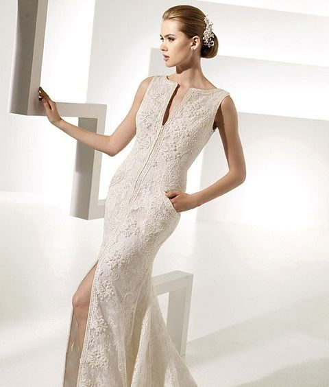 textural lace fitting wedding dress with a plunging neckline and a front slit and pockets