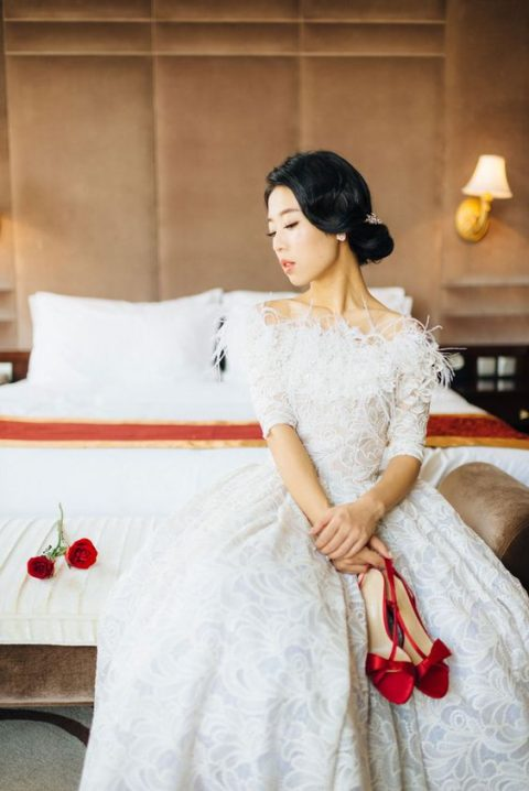 textural off the shoulder short sleeve wedding dress with a feather neckline
