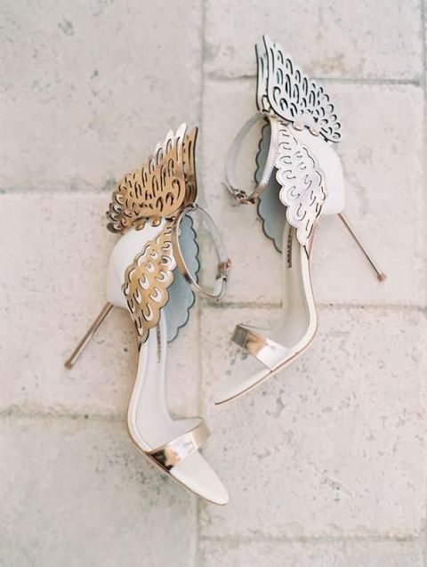 white and metallic laser cut wedding shoes with wings on the back