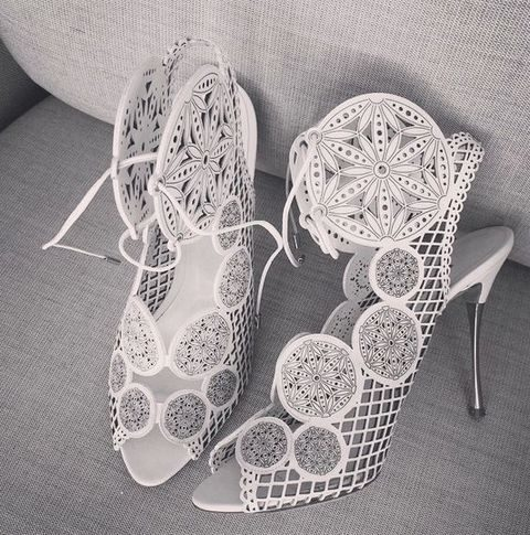 white completely laser cut wedding shoes