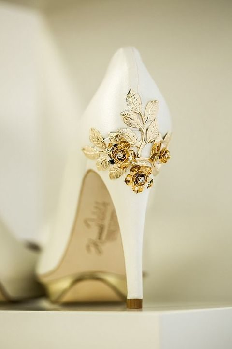 white heels with gold rose and leaf decor on the back