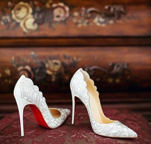 white heels with silver bead decor and a scalloped edge