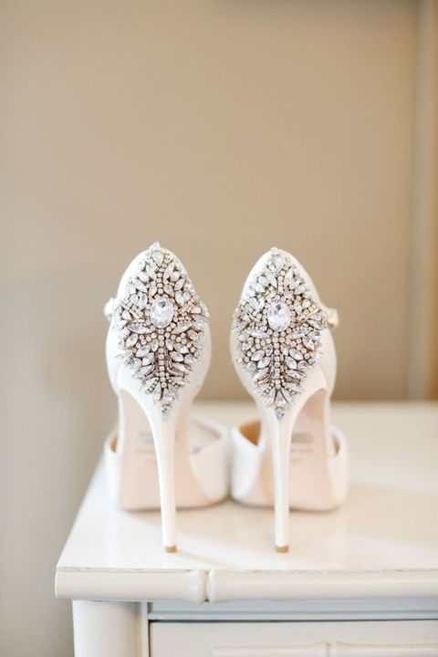 white high heels with heavily crystaled backs