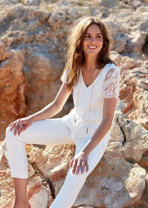 Laure de Sagazan white jumpsuit with a lace bodice and short sleeves and cropped pants