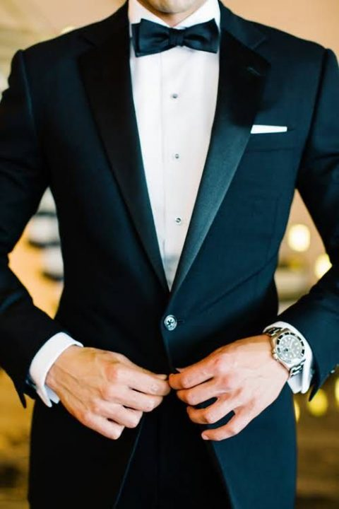 a black dinner jacket with shiny lapels looks very dapper