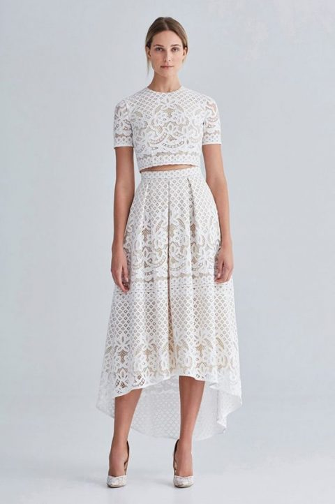 a boho white lace separate with a crop top and a high low skirt