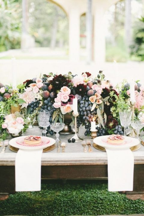 a bowl with grapes, plums, blackberries, figs, ivory, blush and burgundy florals for a lush centerpiece