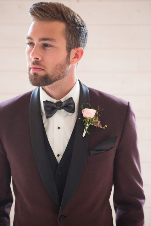 a burgundy dinner jacket with black lapels and a black vest, a faux leather bow tie