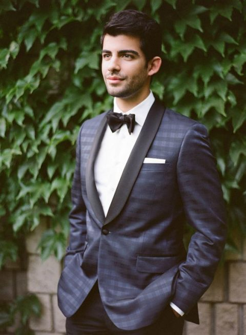 a checked dinner jacket with black lapels and black pants
