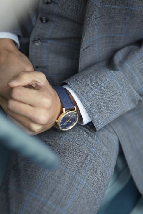 a chic navy watch on a navy band to match the groom's look