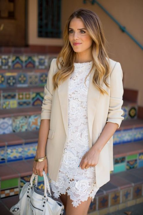 a delicate white lace dress and a neutral oversized menswear blazer