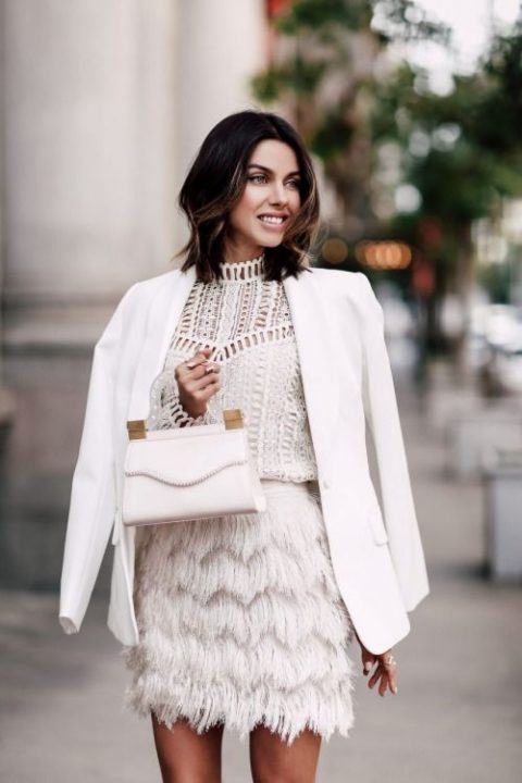 a fringe mini skirt, a white lace top and a white blazer