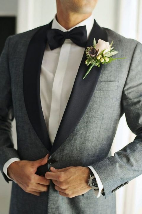a grey dinner jacket with black lapels and a bow tie