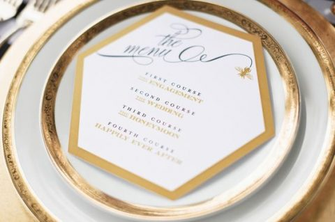 a hex wedding menu with a golded edge looks chic