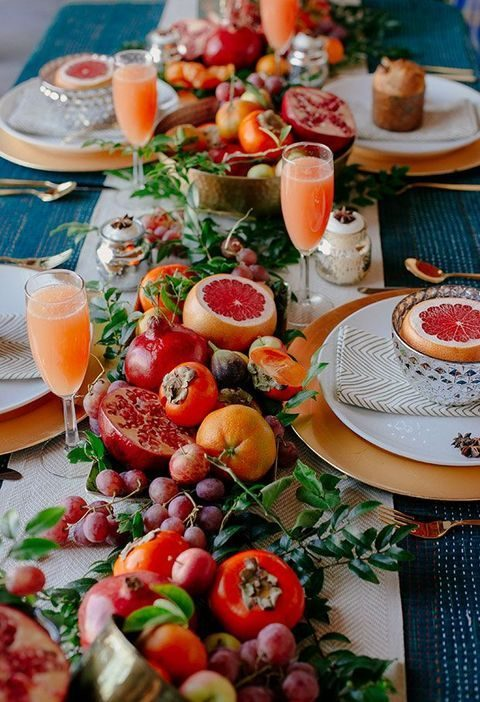 a lush tropical table runner with all fruits possible and greenery