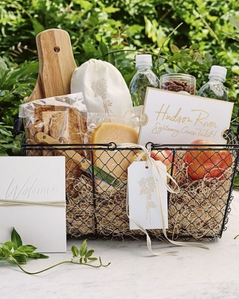 a metal basket for a vineyard wedding that contains local food