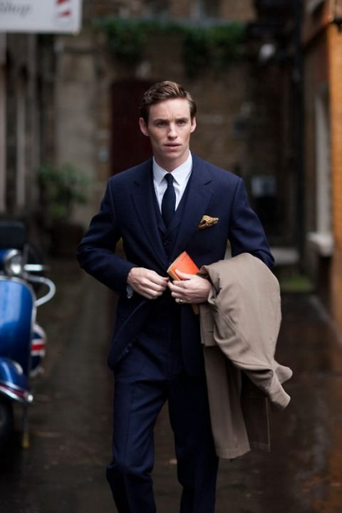 a navy three piece wedding suit with a matching bow tie