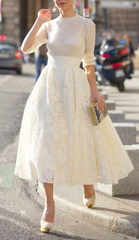 a neutral sweater, an ivory lace midi and platform heels
