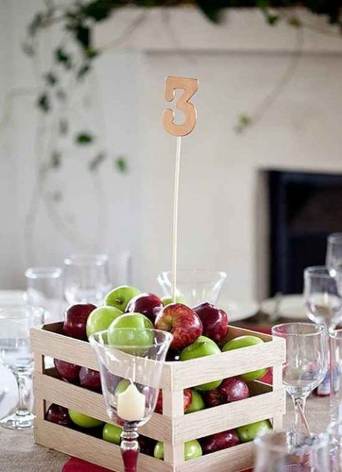 a pallet box with apples and a table number for a fall wedding