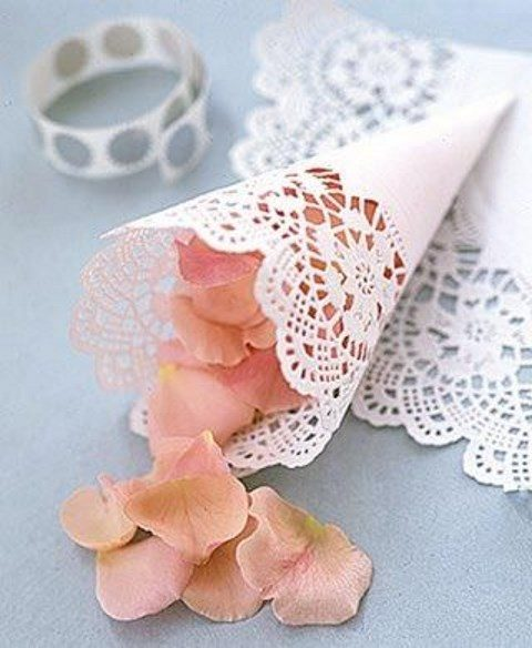 a paper doily with blush petals for your exit