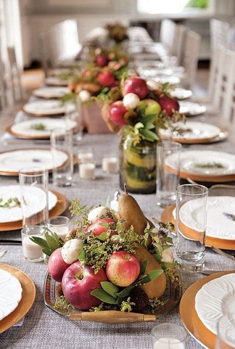 a porcelain tray with pears, apples and mushrooms and greenery for a rustic fall wedding