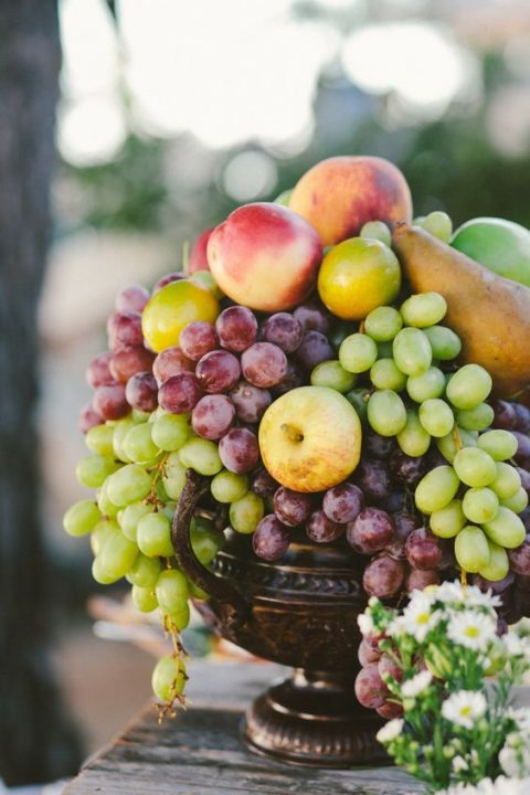 a vintage porcelain bowl with grapes, apples and pears for a summer wedding