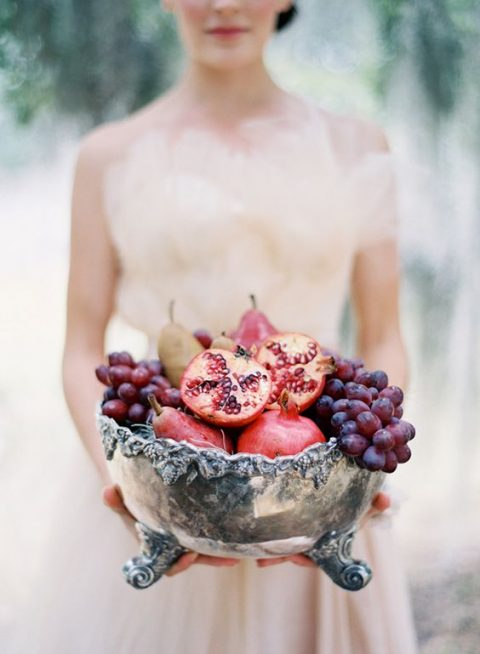 a vintage silver bowl with grapes, pears and pomegranates for a fall wedding