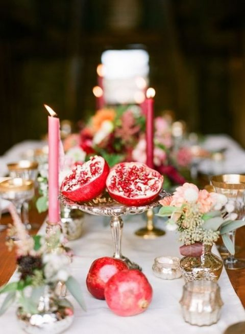 a vintage silver bowl with pomegranates for a fall wedding