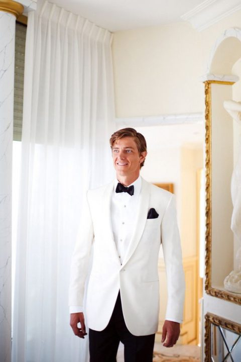 a white dinner jacket, black trousers, a black bow tie and handkerchief