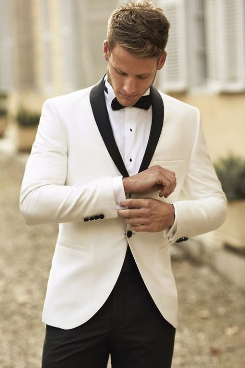 a white dinner jacket with black lapels and black pants