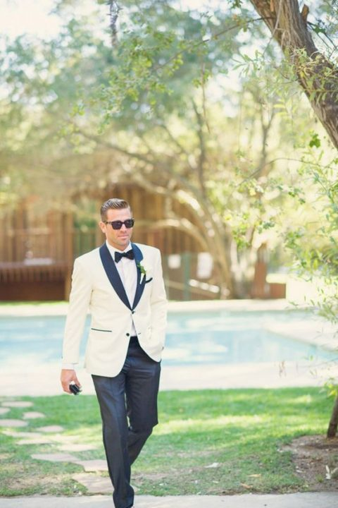 a white dinner jacket with dark grey lapels and dark grey trousers