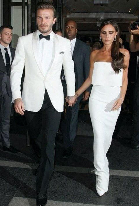 a white dinner jacket with shiny white lapels and black trousers