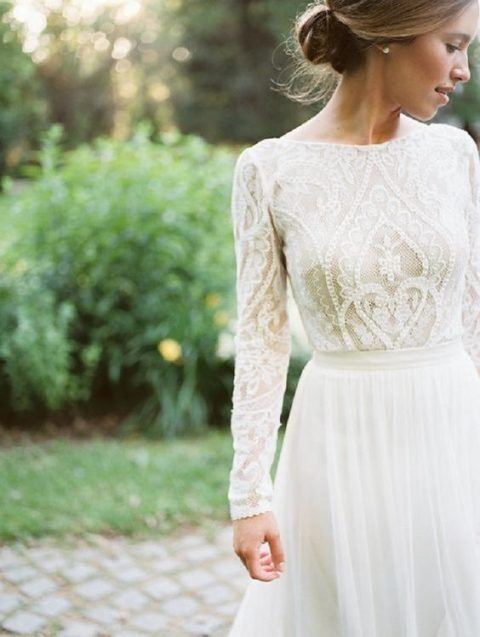 a white long sleeve lace top and a plain white maxi skirt