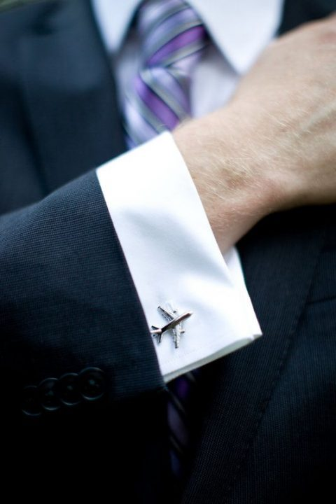 airplane cufflinks for a travel-themed wedding