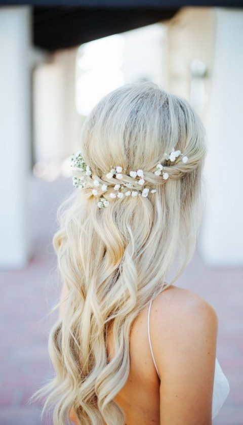 braided half updo with baby's breath tucked in