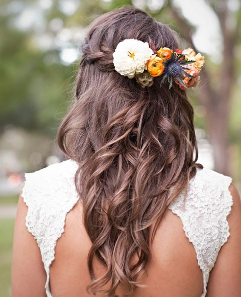 braided half updo with long waves and fall blooms