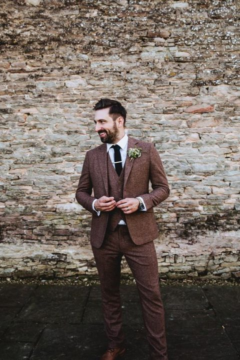 brown tweed three piece wedidng suit with a white shirt and a black tie