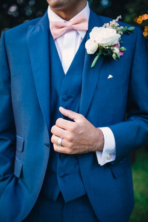 cobalt blue three piece wedding suit with a white shirt and a pink bow tie