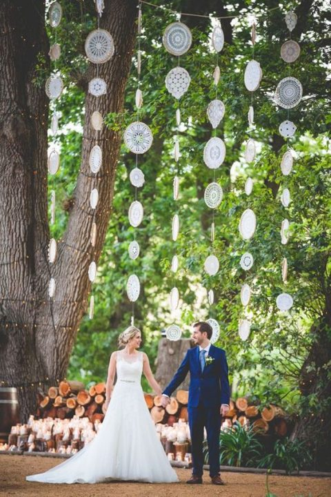 doilies wedding backdrop for an outdoor boho ceremony