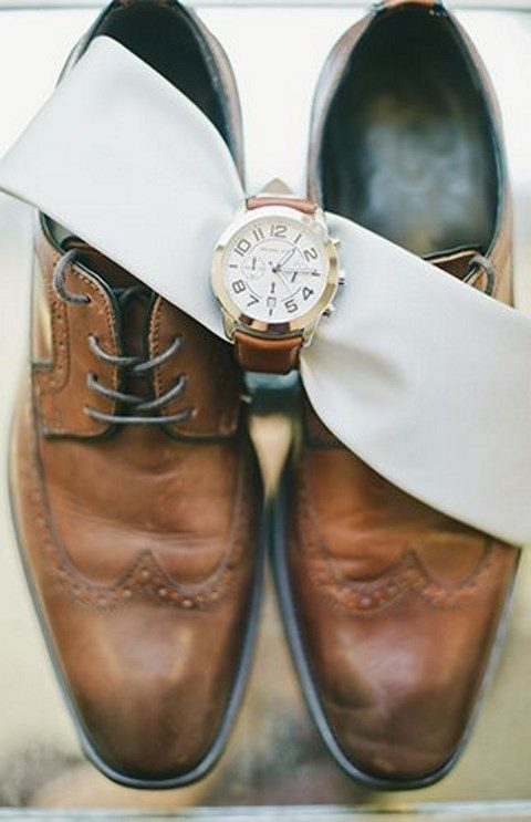 elegant classic watch with a brown leather band