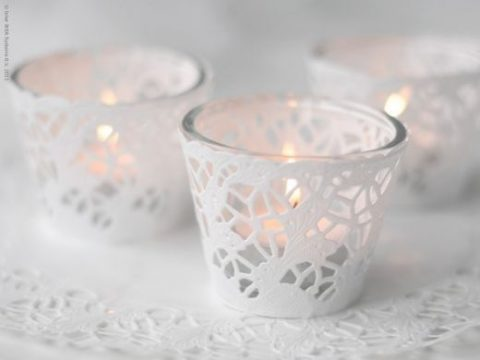 glass candle holders wrapped with doilies look cute