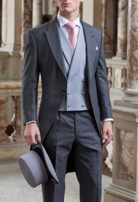 graphite grey suit, a light grey vest and a light pink tie