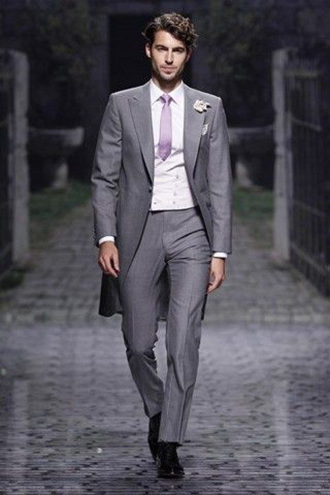 grey morning suit, a white vest, a pink tie