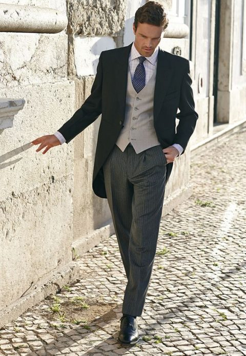 grey striped trousers, a black jacket, a dove grey vest, a checked shirt and a polka dot tie