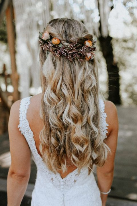 half up half down wavy hair with fall flowers and greenery