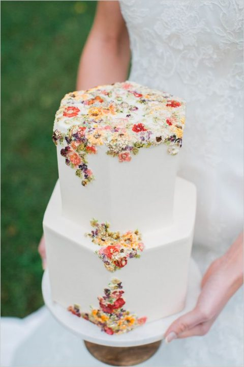 hexagon shaped wedding cake with sugared flower decor