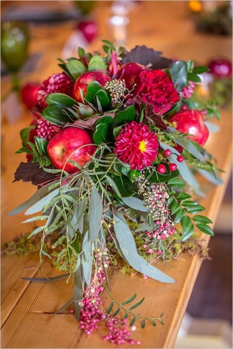 hot red fall centerpiece with dahlias, apples and greenery